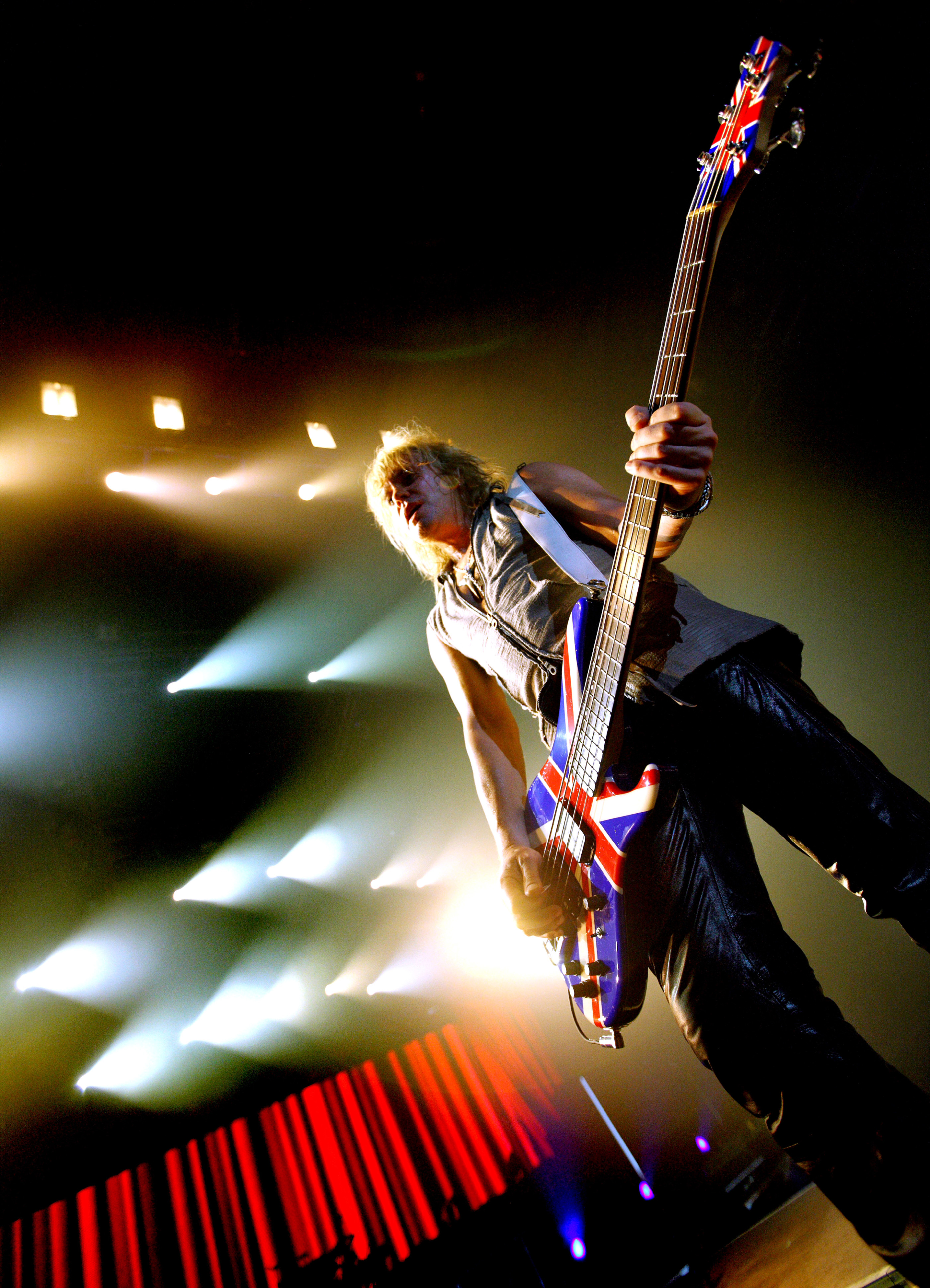 Rick Savage Def Leppard Gateshead onstage 2008 by Ash Newell