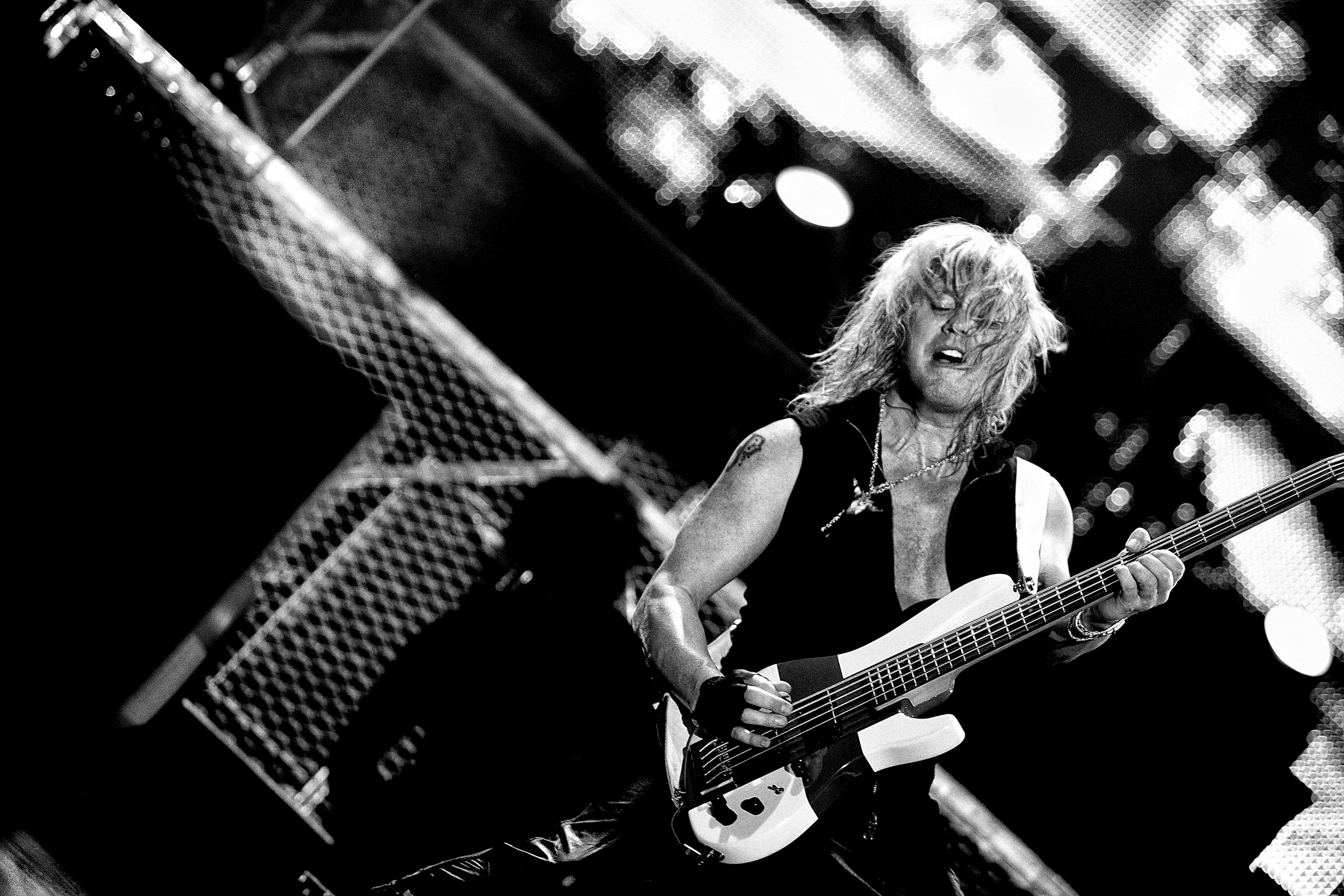 Rick Savage Def Leppard Manchester onstage 2008 by Ash Newell